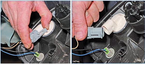 Отжимаем фиксатор проводной колодки, затем отсоединяем ее от патрона.