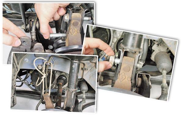 Извлеките верхний и нижний болты крепления поворотного кулака к амортизаторной стойке и подвяжите проволокой поворотный кулак к элементам кузова.
